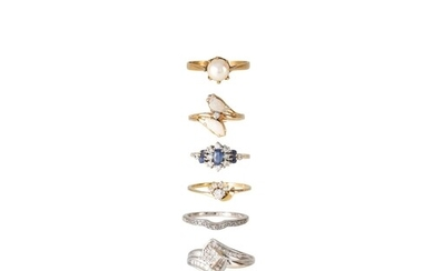 A COLLECTION OF SIX GOLD STONE SET DRESS RINGS, including tw...
