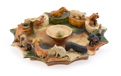 A Chinese sancai pottery tray of twelve-sided fluted form
