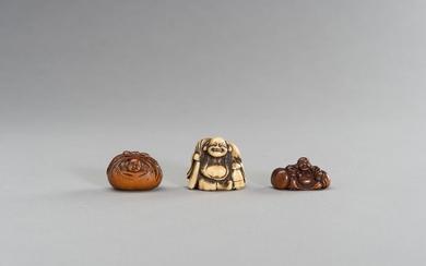 A GROUP OF THREE WOOD AND STAG ANTLER NETSUKE OF HOTEI