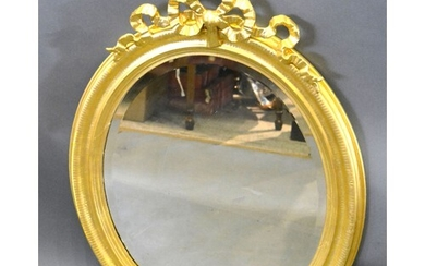 A Late 19th Early 20th Century French Oval Gilded Wall Mirro...