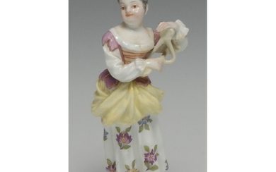 A Meissen figure, of a young girl playing the triangle, in c...