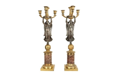A PAIR OF 19TH CENTURY FRENCH EMPIRE STYLE GILT AND PATINATED BRONZE CANDELABRA