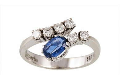 A SAPPHIRE AND DIAMOND DRESS RING, the oval cut sapphire and...