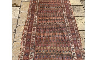 A Tribal rug, multiple borders, centre with repeating geomet...