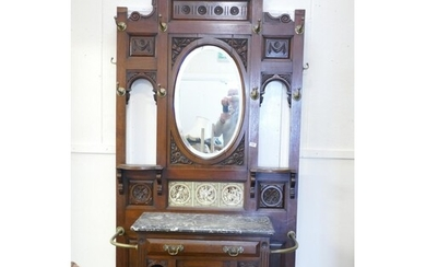 A Victorian walnut hall stand, with broken pediment top over...
