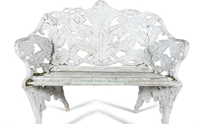 A WHITE PAINTED CAST IRON GARDEN SEAT, of...