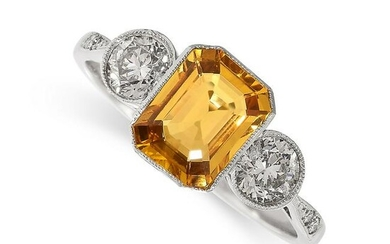 A YELLOW SAPPHIRE AND DIAMOND RING set with an emerald