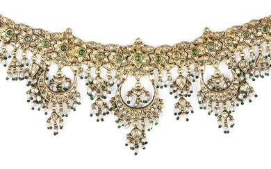 A fine Mughal diamond-set enamelled gold necklace, India, 19th century, the choker band formed of a series of six-petalled flowers set with diamonds and a central emerald with further diamond-set petals above and below, from this are suspended...