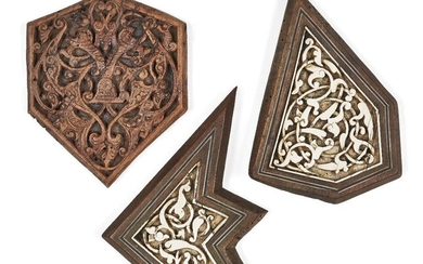 A group of 20th century carved bone inlaid wood panels in the Mamluk style, 10.5cm high; 15cm. and 15.5cm. high (3) Provenance: Private collection of Oliver Hoare 1945-2018