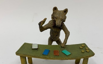 A novelty painted bronze figure, of a croupier at a table, 9...