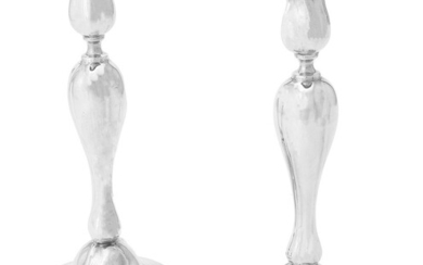 A pair of German silver coloured candlesticks
