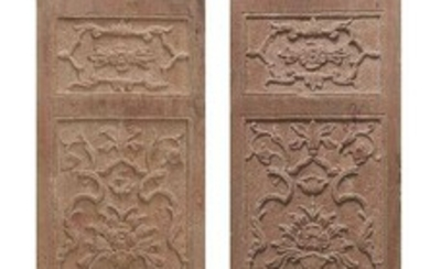 A pair of Mughal carved red sandstone panels, North India, 17th century, of rectangular form, carved in registers with floriated vases, 185 x 35.5cm. (2) (VAT charged on hammer price)