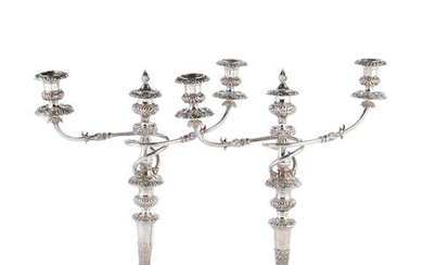 A pair of Old Sheffield Plate three-light candelabra and a pair of candlesticks ensuite early 19th century (4)