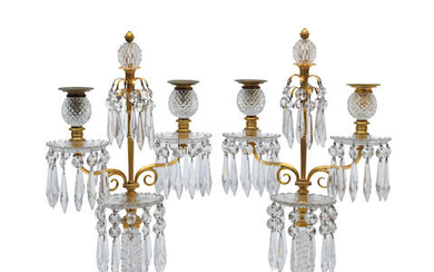 A pair of ormolu-mounted, cut and moulded glass two-light candelabra