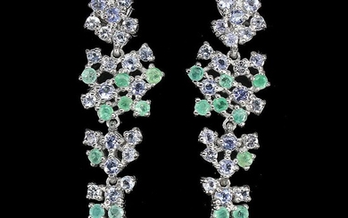 NOT SOLD. A pair of tanzanite and emerald ear pendants each set with numerous circular-cut...