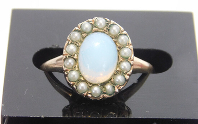 ANTIQUE YELLOW METAL OPAL AND SEED PEARL CLUSTER RING.