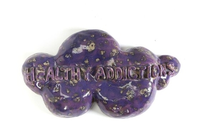 Annesofie Sandal: ''Healthy Addictions'', 2006. Signed and dated on the reverse. Ceramic sculpture with purple glaze. H. 5 cm. B. 30 cm. D. 17 cm. – Bruun Rasmussen Auctioneers of Fine Art