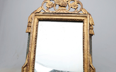 French mirror with Louis XVI frame in carved and gilded wood, last quarter of the 18th Century.