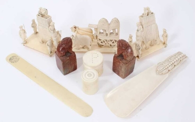 Group of antique ivory to include three processional figures, tow carved soapstone figures and other items