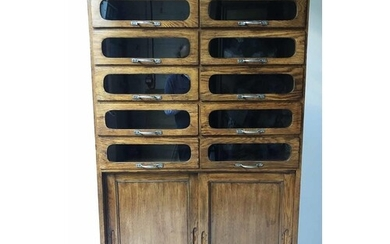 HABERDASHERY CABINET, mid 20th century oak with ten glazed d...