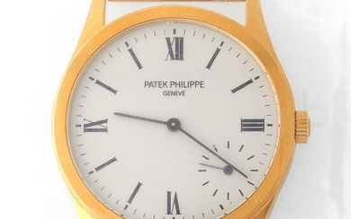 Patek Philippe. Limited Edition and Sophisticated Calatrava Wristwatch in Yellow Gold Reference 5026, With Silver Dial Made for the New Millennium and Extract from Archives