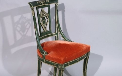 SIX CHAIRS in carved wood molded and stained green. Decorated...