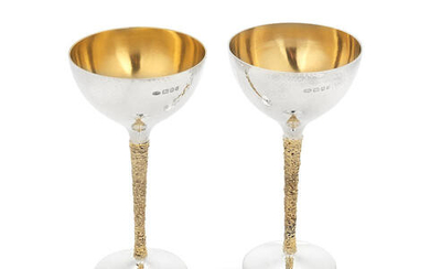 STUART DEVLIN: two silver and silver-gilt coupes/flutes
