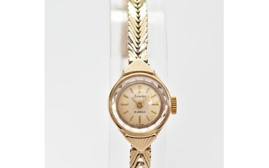 A 9CT GOLD LADY'S ACCURIST WRIST WATCH, the circular face wi...