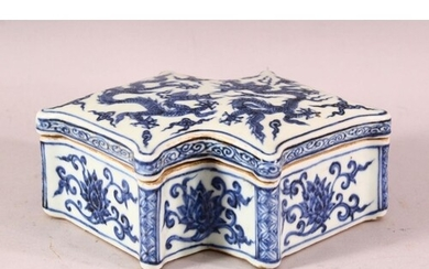A CHINESE MING STYLE BLUE & WHITE PORCELAIN LIDDED DRAGON BO...