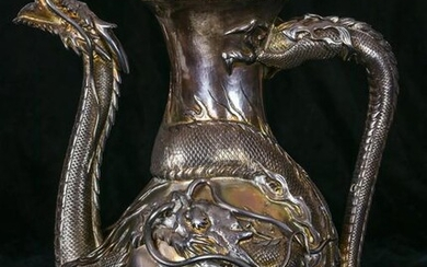 A Chinese Export dragon silver teapot
