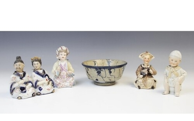A Chinese 'nodding' figural group, modelled as a man and wom...