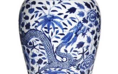 A Chinese porcelain blue and white 'dragons and peonies' baluster vase, 19th century, painted with a pair of four-clawed dragons amongst flowering peony blossoms and leafy stems, apocryphal underglaze blue four-character Kangxi mark to base, 31cm...