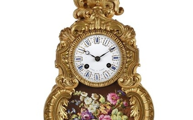 A FRENCH LOUIS PHILIPPE PORCELAIN INSET ORMOLU MANTEL CLOCK