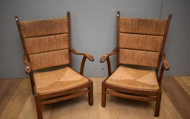 A PAIR OF DESIGNER FRENCH OAK AND RATAN BACK AND REMOVABLE SEAT ARM CHAIRS (A/F) (96H x 72W x 72D CM) (LEONARD JOEL DELIVERY SIZE: L...
