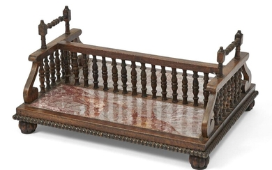 A Regency style rosewood and marble inlaid book stand, early 20th century, the baluster central gallery flanked by scroll sides, with gadrooned border to the base and bun feet, with partial label to underside, 43cm wide