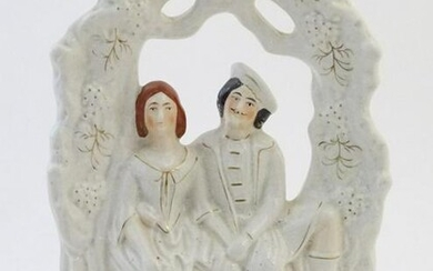A Staffordshire pottery flat back figural group