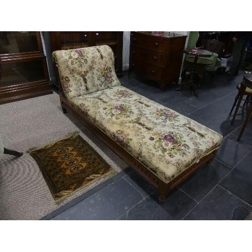 A Victorian mahogany framed Day Bed, with carved and pierced...