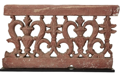 A carved and pierced double-sided sandstone balustrade fragment, Agra, India, period of Shah Jahan mid-17th century, with flower buds alternating with flowering vases on a ground of openwork scrolling vine, 37cm. high x 67cm wide This fragment...