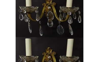 A pair of 20thC gilt twin branch wall lights, the gilt mount...