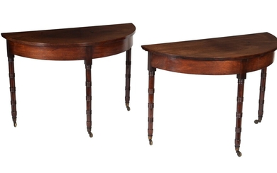 A pair of Regency mahogany demi lune side tables