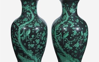 A pair of famille noir-decorated porcelain baluster vases Sold...