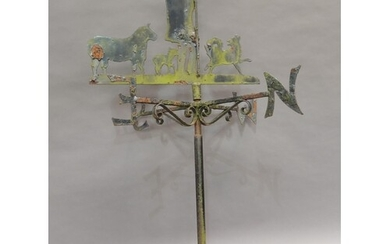 A wrought iron weather vane with shepherd sheep, and sheep d...