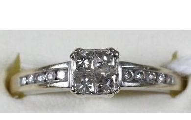 An 18ct white gold diamond ring, claw set with four Princess...