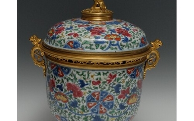An ormolu mounted Chinese jar and cover, brightly painted in...