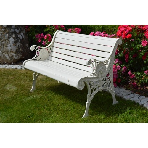 Garden bench with wooden slats and decorative cast iron seat...