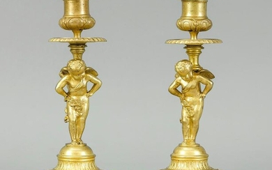 Pair of candlesticks with putti, 19
