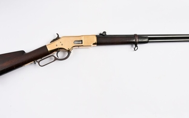 """WINCHESTER REPEATING SADDLE GUN.Model 1866, cal. 44/40/. Marking of the barrel """"winchester repeating arms newhaven. ct. kings inprovement patented march 25 1866"""". Cullasse bearing the number 60841. Gun in good condition and use, tanning slightly..."""