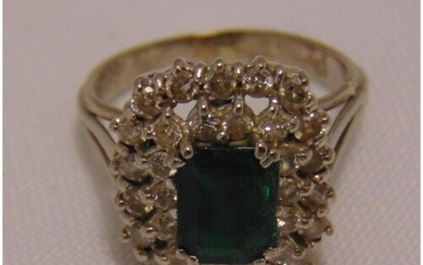 White gold diamond and emerald ring, tested 18ct, approx tot...
