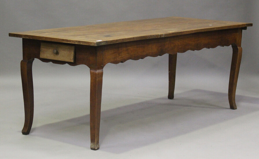 A 19th century French cherrywood kitchen table, fitted with a drawer and slide, on cabriole legs, he