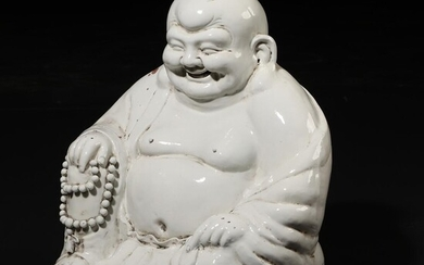 A Chinese blanc de chine figure of Laughing Buddha seated with his mala and his sac. 20th century. H. 44 cm. – Bruun Rasmussen Auctioneers of Fine Art